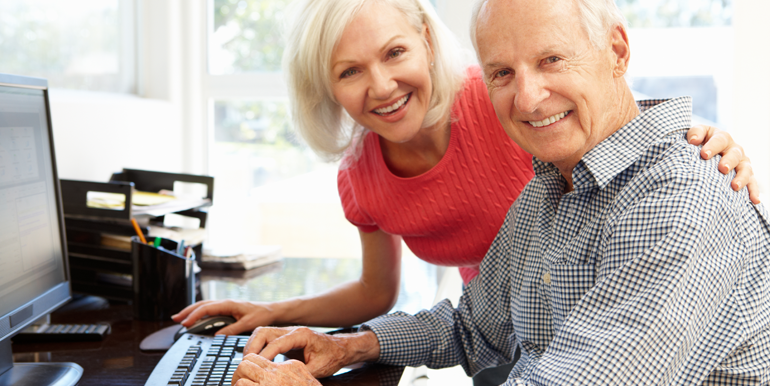 lowder_new_homes_grand_park_older_couple_on_computer