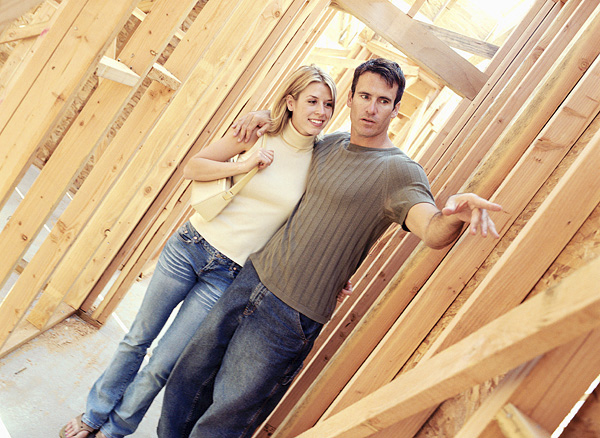 Couple at construction site for new home